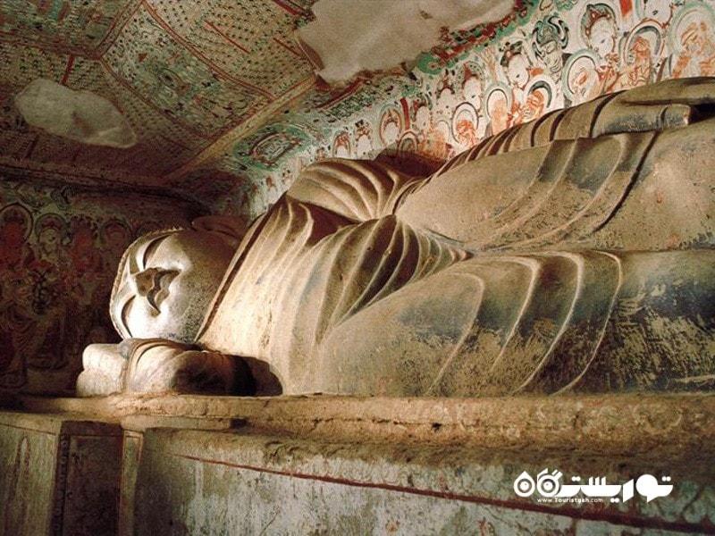 18.غارهای موگای (Mogao Caves)، چین